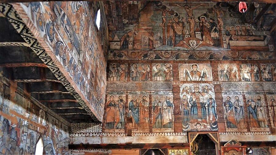 Ieud UNESCO wooden church Maramures Ponehalski painting